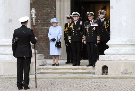 Queen Elizabeth II, accompanied by First Sea Lord, Admiral Sir Mark Stanhope and her husband Prince Philip