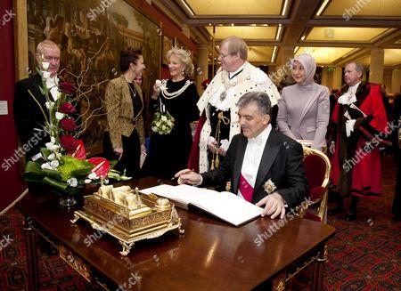 President Abdullah Gul signing the visitors book, also Princess Michael of Kent, Lord Mayor of the City of London Alderman David Wootton and Hayrunnisa Gul