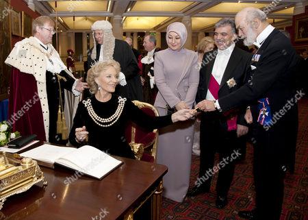 Princess Michael of Kent signing the visitors book, also Lord Mayor of the City of London Alderman David Wootton, Hayrunnisa Gul, President Abdullah Gul and Prince Michael of Kent