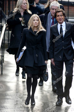 Sienna Miller arrives at court with her lawyer David Sherborne