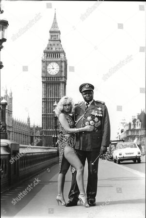 Stock Picture of Actor Joseph Olita As Idi Amin. He Was In London To Promote The Film Amin The Rise And Fall. He Is Pictured With Model Susie Silvey