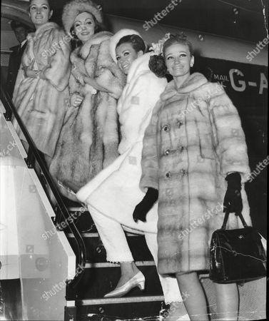 London's Top Fashion Models Joan Fullard Gilian Evanne Angela Pringle (now Mrs Jonathan Sieff) And Troudi Line Boarding Their Flight To Belfast