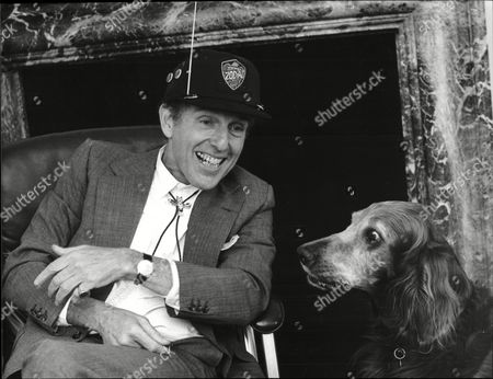 Stock Picture of Maurice Oberstein Of Cbs Records With Dog Charlie 1987.