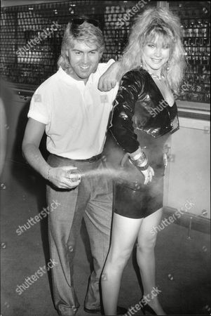 Editorial image of Singer With Pop Group Bucks Fizz Mike Nolan With Group Member Shelly Preston