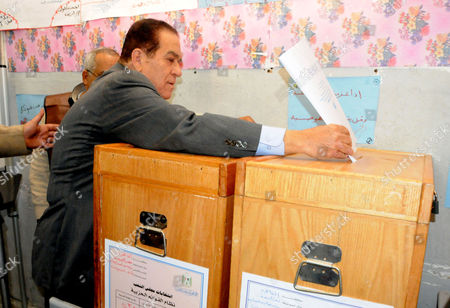 Editorial photo of Prime Minister-Designate Kamal Ganzouri casts his vote in the parliamentary elections, Heliopolis, Cairo, Egypt - 28 Nov 2011