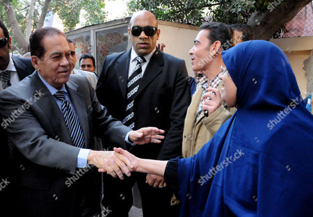 Stock Photo of Prime Minister-Designate Kamal Ganzouri meets supporters at a polling station