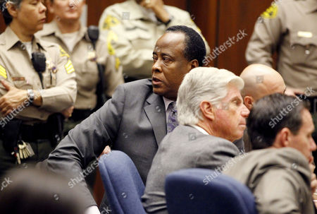 Dr. Conrad Murray with defence attorney J Michael Flanagan