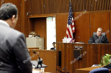 Stock Picture of Judge Michael E Pastor (R) listens to Attorney Brian Panish