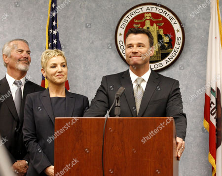 Los Angeles Deputy District Attorney David Walgren, co-prosecutor Deborah Brazil (C) and major crimes division head Deputy District Attorney Gary Hearnsberger (L)