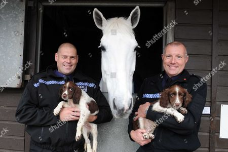 PC Leighton Andrews and Norman and PC Adrian Lang with Woody