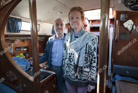 Paul And Rachel Chandler In The Galley Of The Lynn Rival For The First Time Since Their Capture By Somalia Pirates While Sailing Close To The Seychelles 26.11.10