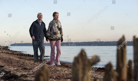 Paul And Rachel Chandler Stroll Along The Seashore After Visiting The Lynn Rival For The First Time Since Their Capture By Somalia Pirates 26.11.10