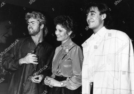 Wham At Ivor Novello Awards 1985. L-r: George Michael Angela Rippon And Andrew Ridgley. Andrew Ridgley And George Michael Of Pop Group Wham!