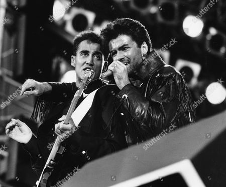 Stock Picture of Wham Last Concert At Wembley. L-r: Andrew Ridgley And George Michael Of Pop Group Wham!