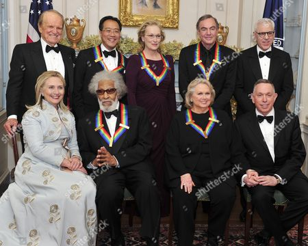 Back row, from left to right: George Stevens, Jr, creator of The Kennedy Center Honors, Yo-Yo Ma, Meryl Streep, Neil Diamond and David M. Rubenstein, Chairman, John F. Kennedy Center for the Performing Arts. Front row, from left to right: Hillary Clinton, Sonny Rollins, Barbara Cook and Michael M. Kaiser, President, John F. Kennedy Center for the Performing Arts