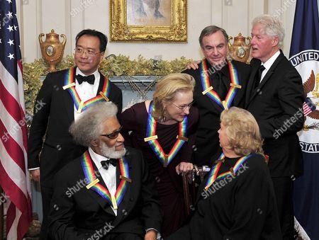 Back row, Yo-Yo Ma, Meryl Streep, Neil Diamond, Bill Clinton. Front row, Sonny Rollins, Barbara Cook