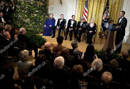 From left: actress Barbara Cook, singer Neil Diamond, musician Yo-Yo Ma, musician Sonny Rollins and actress Meryl Streep listen while United States President Barack Obama speaks