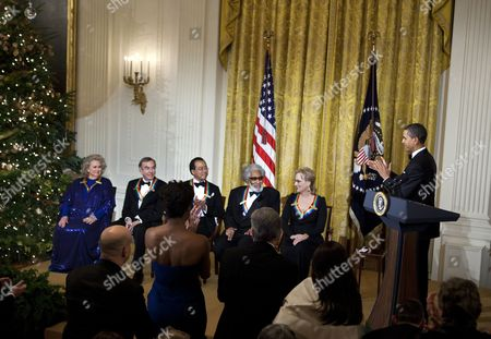 United States President Barack Obama (R) claps for actress Barbara Cook (L), singer Neil Diamond (2L), musician Yo-Yo Ma (3L), musician Sonny Rollins (3R) and actress Meryl Streep
