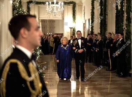 Barbara Cook is escorted through the Cross Hall of the White House to the East Room