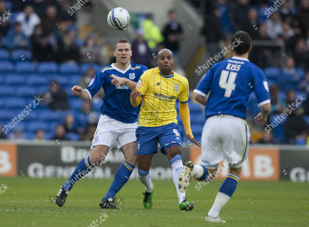 Ben Turner of Cardiff City and Marlon King of Birmingham City in action
