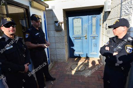 The Israeli police force wait for Moshe Katzav outside his home before he begins a seven-year sentence in prison