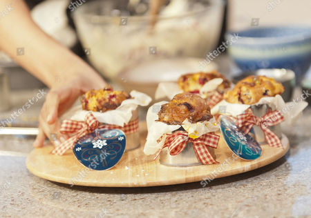Stock Photo of Ravinder Bhogal, makes sure we get two of our five a day with Cranberry, Clementine and White Chocolate cakes.
