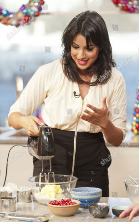 Stock Image of Ravinder Bhogal, makes sure we get two of our five a day with Cranberry, Clementine and White Chocolate cakes.