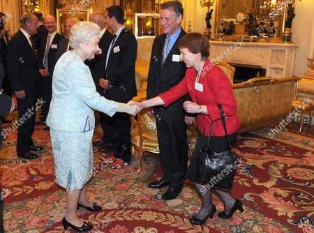 Queen Elizabeth II meets Dr Helen Sharman as Michael Palin looks on