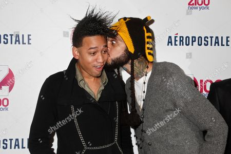 Stock Photo of Tim William and Travie McCoy