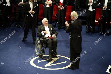 Swedish poet Tomas Transtromer receives the Nobel Prize for Literature from King Carl Gustaf of Sweden