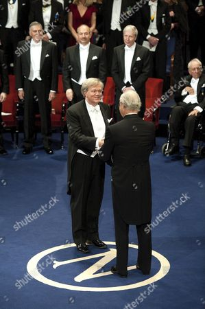 Australian astrophysicist Brian Schmidt receives the Nobel Prize for Physics from King Carl Gustaf of Sweden