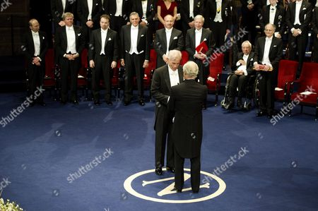 American Christopher A Sims receives the Nobel Prize for Economics from King Carl Gustaf of Sweden
