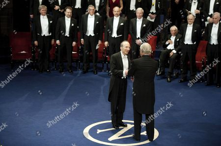 Stock Photo of American astrophysicist Saul Perlmutter receives the Nobel Prize for Physics from King Carl Gustaf of Sweden