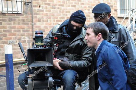 Martin Compston looking a film takes