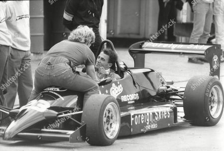 Editorial image of Andrew Ridgley In His Formula Iii Car Driving Into The Pits At Brands Hatch 150mph. Ridgley Was One Half Of The Eighties Pop Group Wham