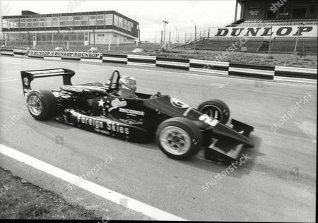 Stock Image of Andrew Ridgley In His Formula Iii Car Driving Into The Pits At Brands Hatch 150mph. Ridgley Was One Half Of The Eighties Pop Group Wham