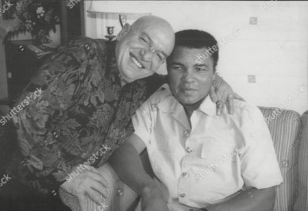 Actor Telly Savalas And Boxer Muhammad Ali (formerly: Cassius Clay). Together In The Imperial Suite At The Carlton Hotel Cannes During The Mipcom Tv Festival.