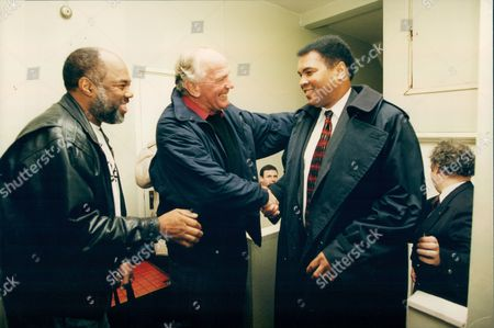 Boxers Muhammad Ali (formerly: Cassius Clay) (right) And Sir Henry Cooper (centre) Meeting At Cooper's Old Kent Road Gym In South London. Ali Was There For A Book Signing. Also Pictured (left) Is Photographer Howard Bingham Who Photographed Ali Through His Career.