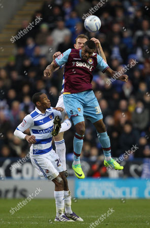Frederic Piquionne of West Ham United in action with Shaun Cummings of Reading