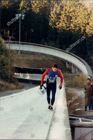 Former Sprinter Allan Wells With Parachute Regiment No 2 British Bobsleigh Team Winterberg Germany For Four-man National Championships 1990. Shows Wells On Track After Falling From Bobsleigh.