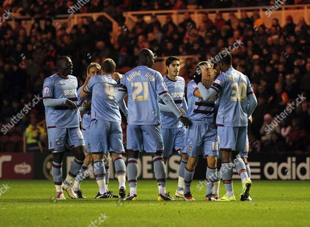Frederic Piquionne of West Ham United celebrates scoring the opening goal of the game with his team-mates