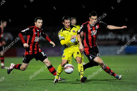 Michael Doyle of Sheffield United (left) and Steven Gregory of AFC Bournemouth