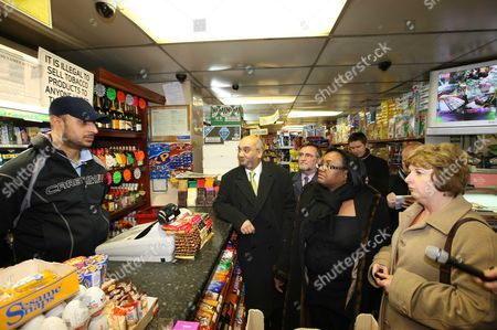Diane Abbott Mp Along With Members Of The Home Office Select Committee Show How Safe Hackney Is On A Late Night Walkabout. Keith Vaz Mp (blue Coat) Karen Buck Mp (blond Hair) And Gwyn Prosser Talk With Bulent Gurgur At The Church Street Supermarket. Picture By: Nigel Howard Email: Nrhpixatyahoo.com Mobile + 44 (0) 7831 235235