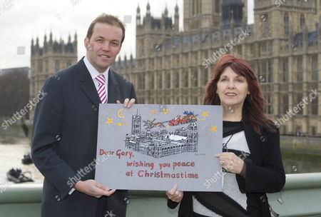 Gary Mckinnon's Mother Janis Sharp With A Christmas Card Signed By Mp's Trying To Stop Gary Being Extradited To America For Trial On Computer Hacking Charges. Pic Shows Janis With Gary's Mp David Burrows.