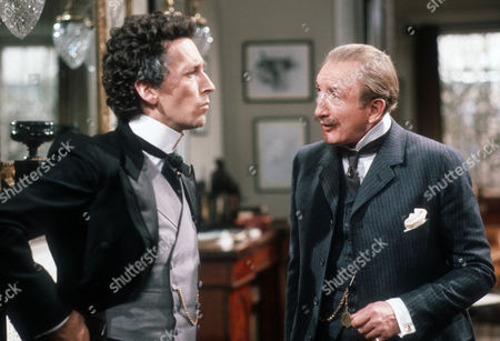 Robert Powell as Professor Henry Higgins and Ronald Fraser as Colonel Pickering