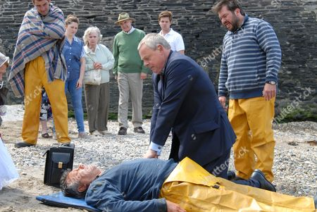 John Duttine as Paul Hale and Martin Clunes as Dr Martin Ellingham