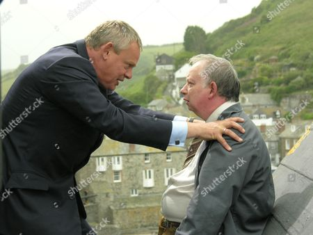 Martin Clunes as Dr Martin Ellingham and Brian Pettifer as Mr Coley