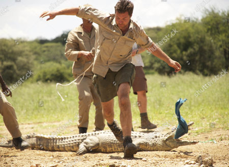 Steve Leonard makes a hasty retreat after releasing a crocodile during  it's relocation in the Erindi Game Park