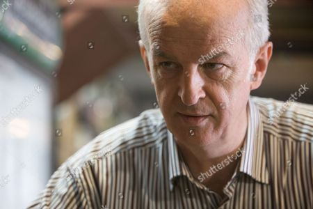 Sean McGinley as Garda Finbarr Colvin.