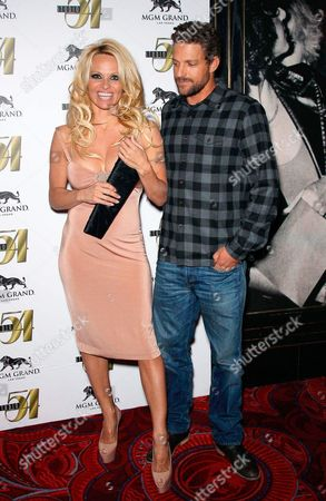 Stock Image of Pamela Anderson and Jon Rose